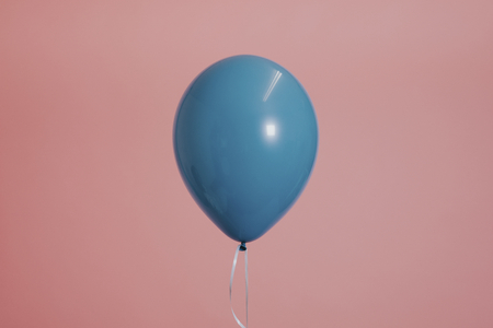 Blue single balloon with a string 스톡 콘텐츠