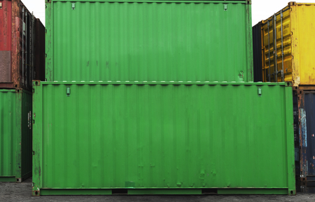 Stacked container boxes in green Stock Photo