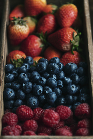 Fresh berries in a wooden box Stock Photo