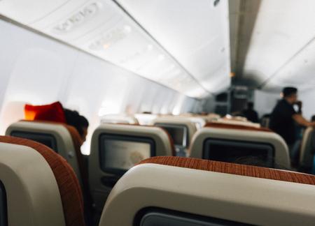 Passengers in an economy class airplane Foto de archivo