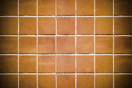 Vignette brownish orange tiles textured background