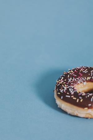 Tasty glazed donut with sprinkles