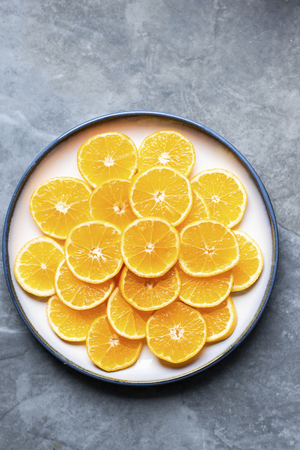 Mandarin slices on a bowl