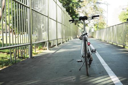 White bike parking on a street side