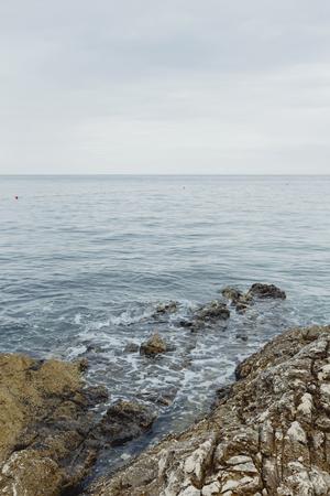 Calm sea gently hitting the rocks