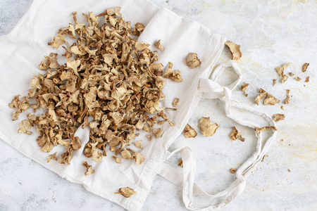 Dried mushrooms on a white tote bag