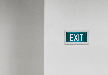 Exit signboard on a white wall Stock fotó - 118447982