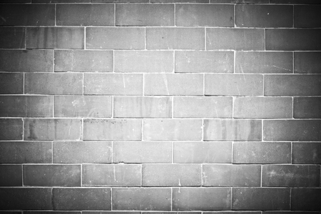 Vignette gray brick wall textured background