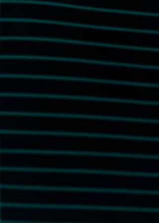 Green lined pattern textured backdrop Фото со стока