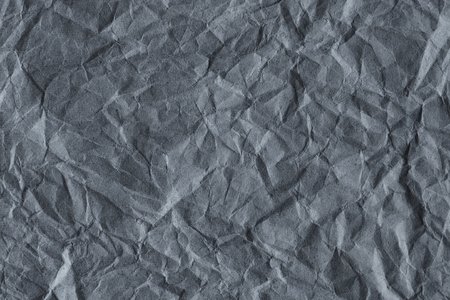 Gray scrunched paper textured background Stockfoto