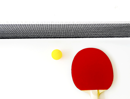 Racket and a ball on a tennis table