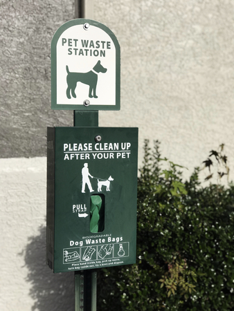 Green outdoor pet waste station Stock Photo - 118448129