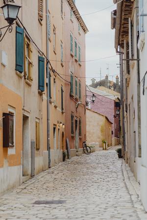 Narrow street with orange buildings