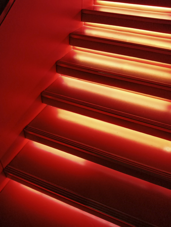 Stairs in red neon light 版權商用圖片