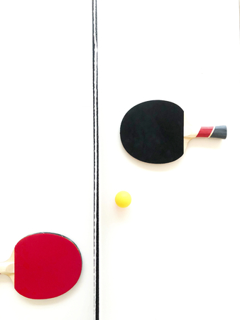 Rackets and a ball on a tennis table Reklamní fotografie