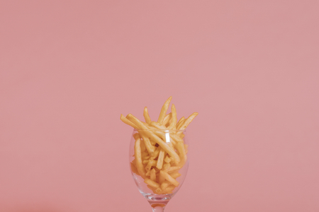 French fries in a wine glass Banco de Imagens
