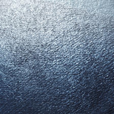 Blue shiny textured paper background Фото со стока