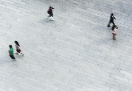 Aerial shot of people walking on the ground Stock fotó