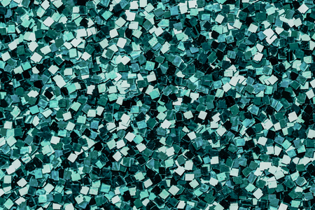 Shiny green sequins textured background Stock Photo