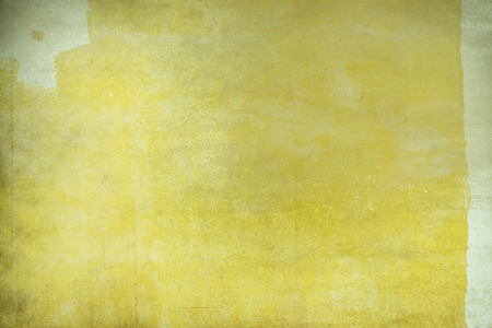 Yellow paint on a concrete wall