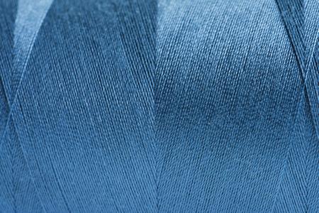 Fondo del tessuto del filato di lana arrotolato