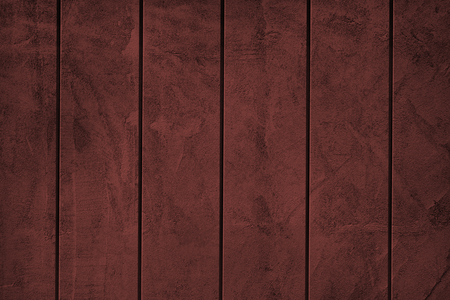 Deep red paint exposed concrete wall textured background