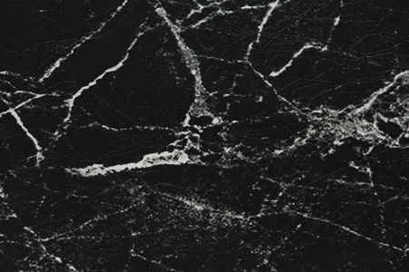 Black grungy textured paper background Imagens