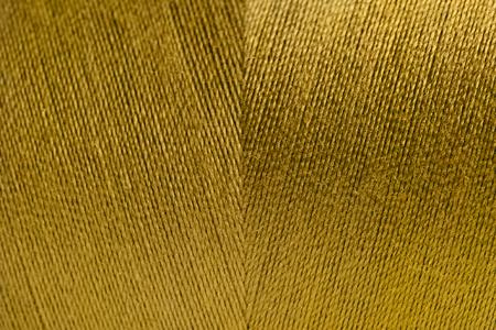 Golden rolled yarn texture background