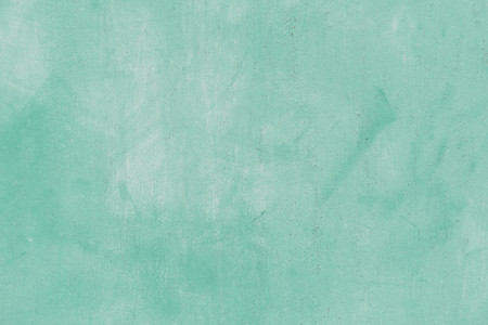 Turquoise green painted concrete textured background