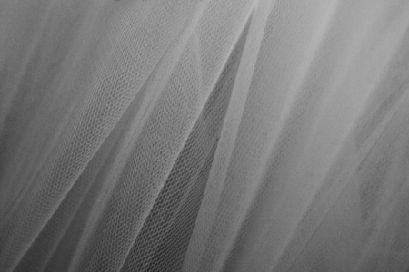 Hanging drape with net textured background