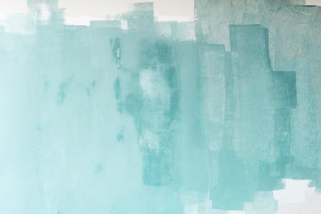 Pintado de verde sobre un muro de hormigón