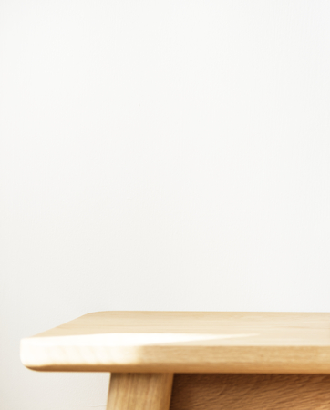 White wall with wooden table product background