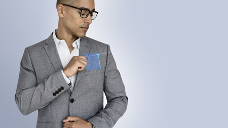 Casual man reaching for a translucent blue card from his suit pocket