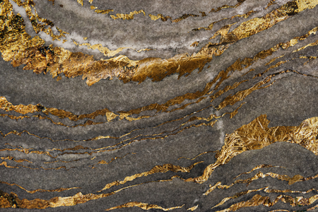 Gray marble rock with gold textured background