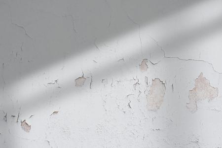 Shadow on a damaged wall