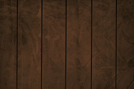 Dark brown paint exposed concrete wall textured background