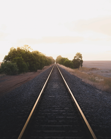 Railroad in the countryside under a golden sky