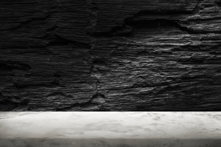 Rough dark gray cement wall with white marble floor product background