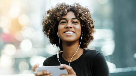 Girl listening to music from her phone