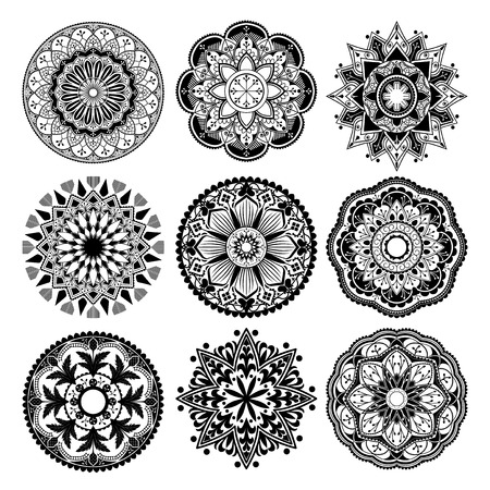 Black mandalas patterns set on white background