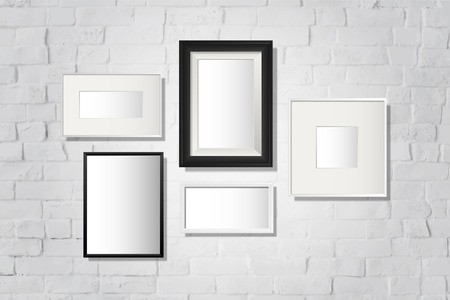 Frame mockup collection on a wall vector