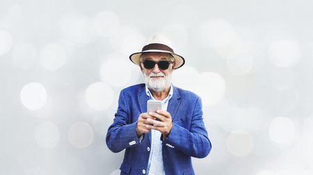 Elderly man is using mobile phone