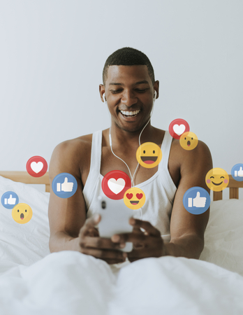 Black man watching a live streaming on his bed Stock Photo
