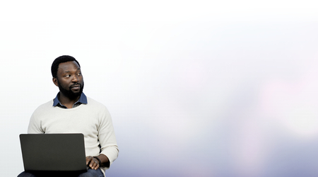 Black man working on his laptop