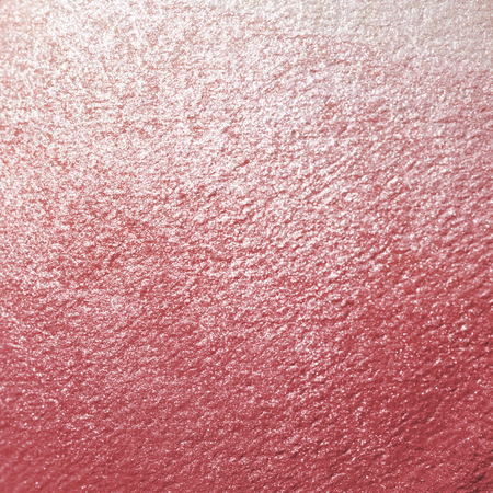 Pink shiny textured paper background