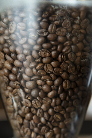 Close up of coffee beans in a grinder