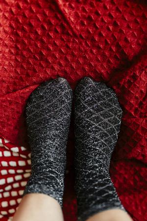 Pair of silvery black socks on a Christmas holiday Reklamní fotografie - 119082598
