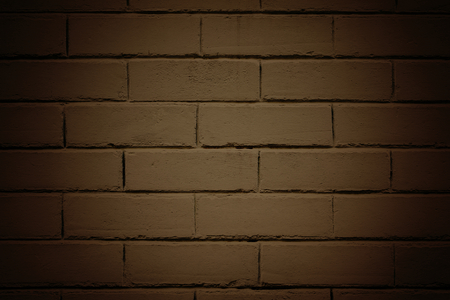 Vignette brown brick wall textured background Фото со стока