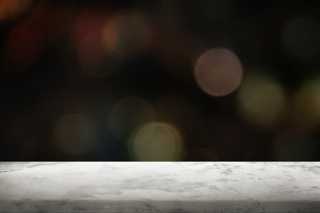 Black bokeh background with white marble floor