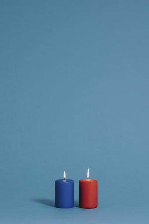 Blue and red burning candles Stock Photo - 118991312
